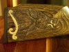 wild-boar-carving-on-laminate-gunstock-image